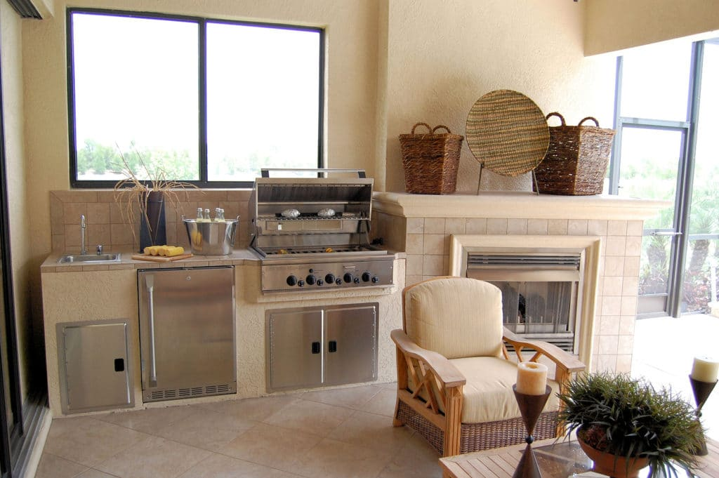Outdoor kitchen and sitting area with fireplace