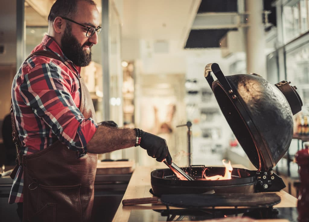 Chef preparing charcoals before grilling in a restaurant