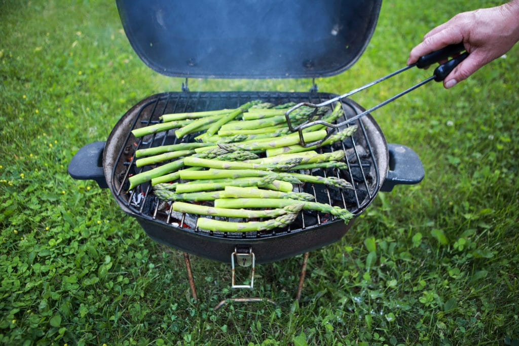 Grilling asparagus in the backyard