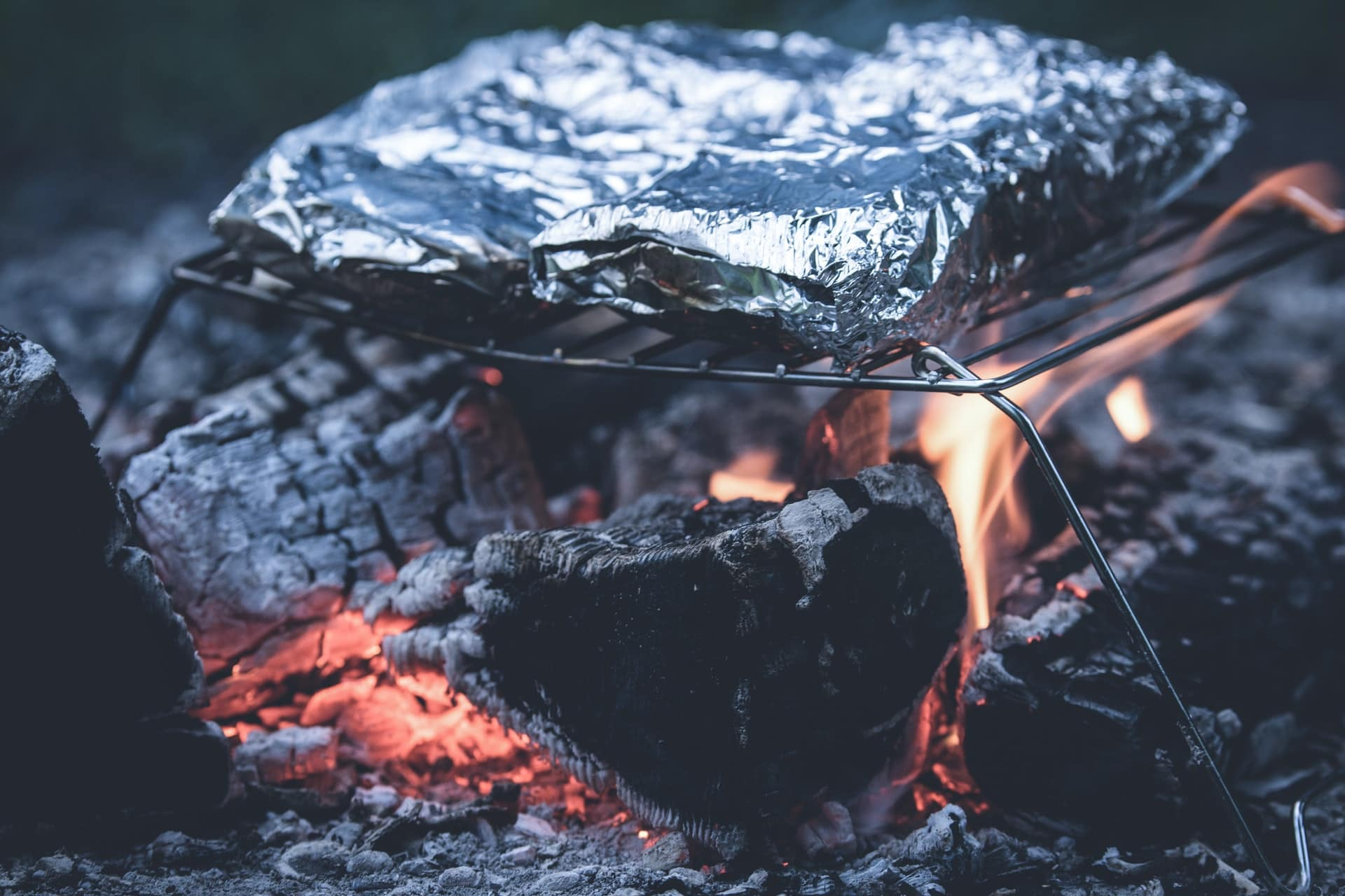 food wrapped in tinfoil on grill